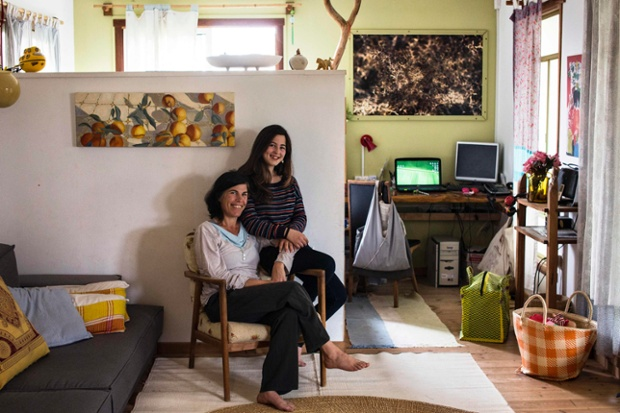 Vered, 43, poses for a photograph with her daughter Alma, 13, in their home in Kibbutz Hukuk near the Sea of Galilee in northern Israel. Vered got a degree in design at the age of 27 and currently runs educational art projects in local communities. Vered hopes that her daughter Alma will find a profession that brings her happiness and satisfaction. Alma will graduate high-school in five years, at the age of 18, and says she would like to be a part of the film industry as a director, camerawoman, editor or actor.