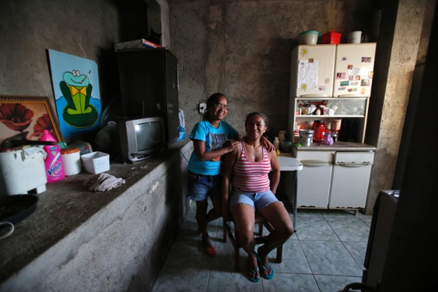 Raimunda Eliandra Alves, 45, poses for a photograph with her daughter Ana Paula Leonardo Justino, 10, at their home at the Pavao-Pavaozinho slum in Rio de Janeiro. Raimunda is a supermarket cashier who finished her education at age 19. When she was a child, she wanted to become a maths teacher when she grew up. She hopes that her daughter Ana Paula will become a veterinarian. Ana Paula says that she will go to high school and then finish college in 2025. She also wants to be a vet when she grows up.