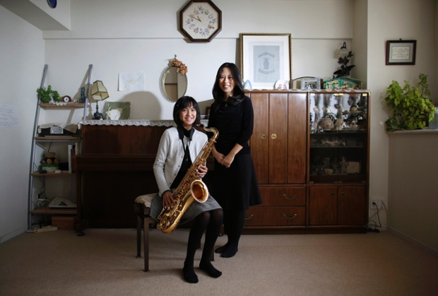Manami Miyazak, 39, and her daughter Nanaha, 13, pose at their home in Tokyo. Manami, who is a housewife, studied until she was 20. Her ambition was to work somewhere where she could meet lots of people. She hopes that her daughter will build a loving home with a happy marriage. She says it would be great if her daughter could find work that makes use of her abilities and interests. Nanaha wants to be either a designer, musician or a nurse.