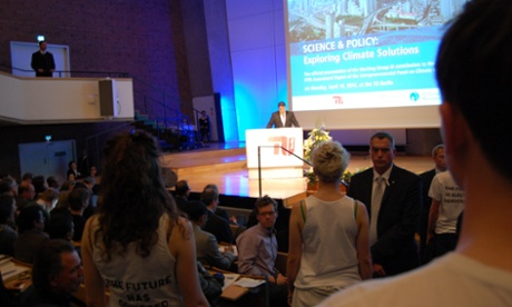Berlin: April 14th 2014. Sigmar Gabriel speaking at the IPCC WG3 briefing. Future protestors watch him in silence.