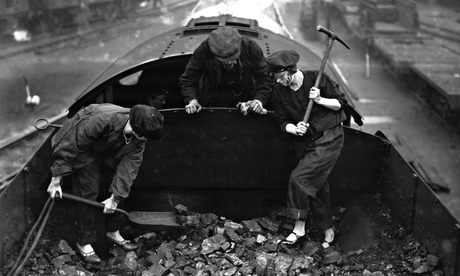 Men and women shovelling coal