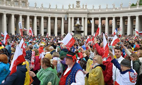 Pilgirms attend the canonisation mass of Popes John XXIII and John Paul II