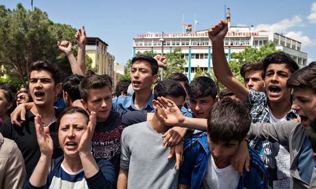 Young people protest outside the mayor's office in Soma, Turkey