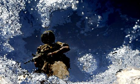 A British Soldier patrols a Gas Plant south of Basra.