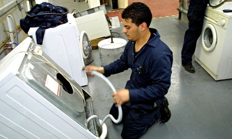 Re-use: Repairing a discarded washing machine.