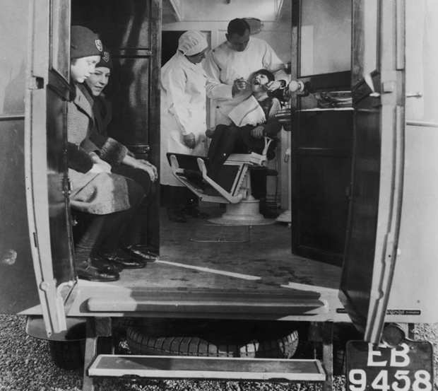 Dentists go mobile - A dentist treats a young girl in a mobile surgery operated for the benefit of local schoolchildren in Cambridgeshire, 1931.