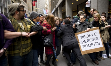 A businessman tries to break through a line of Occupy Wall Street protesters who had blocked access to the New York Stock Exchange area in November 2011.