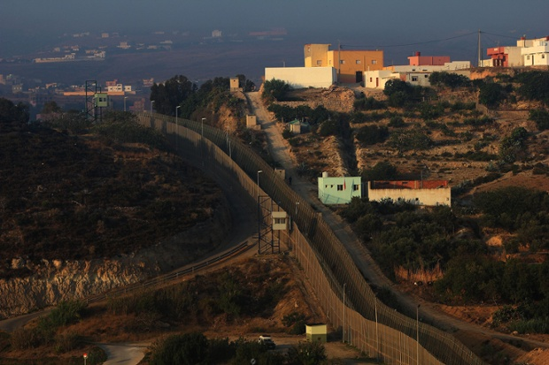 The triple fenced border line separating Morocco from the Spanish enclave of city of Melilla.