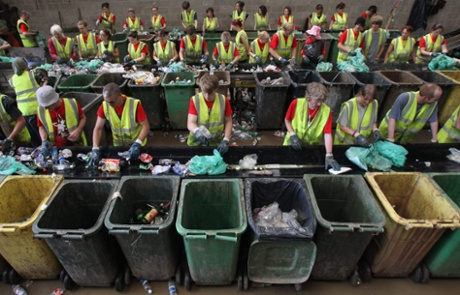 Volunteer workers sort rubbish for recycling at the Glastonbury Festival.