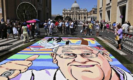 A floral portrait of Pope Francis at St Peter's Basilica at the Vatican.