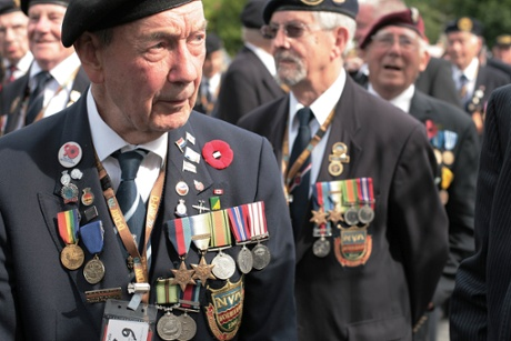 Members of the Normandy Veterans Association on parade in Arromanches.
