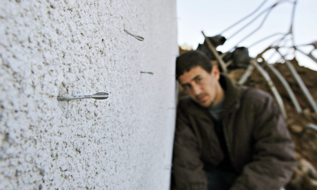 Flechette shell darts embedded in a wall in Gaza