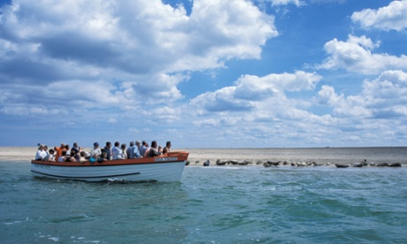 Tourists viewing seals from boat, Blakeney Point, Norfolk.