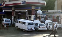 Egyptians gather at a petrol station