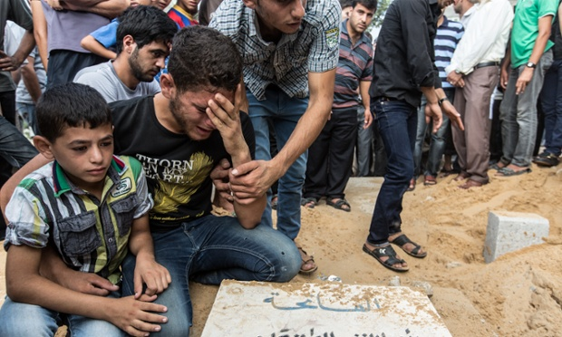 Faraj Aiesh's sons grieve at his graveside