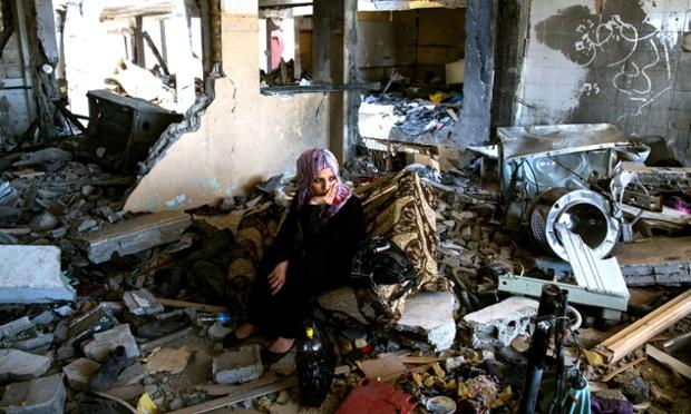 Adir Ali sits in her devastated flat.