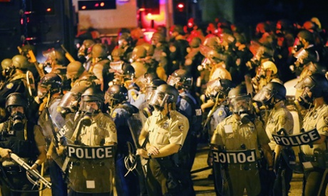 Police advance on demonstrators protesting the killing of teenager Michael Brown in Ferguson, Missouri.