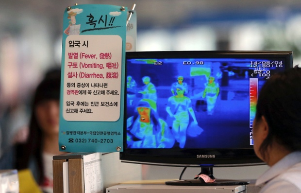 A South Korean quarantine officer checks a thermal camera monitoring the body temperature of passengers arriving from overseas at the Incheon International Airport in Incheon, South Korea.