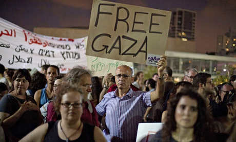 Israelis take part in a protest against Israel's military operation in the Gaza Strip