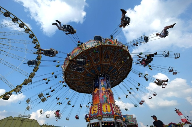 People enjoy the annual funfair in Herne, western Germany