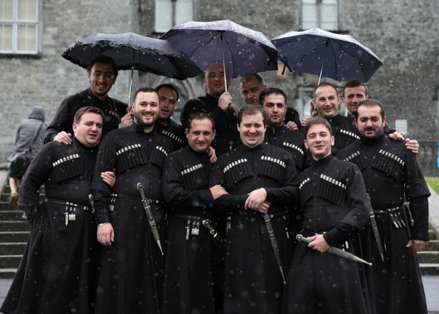 We're singing in the rain....The Basiani Ensemble from Georgia arrive at Kilkenny Castle for the Kilkenny Arts festival which runs over ten days from 8-17 August 2014.