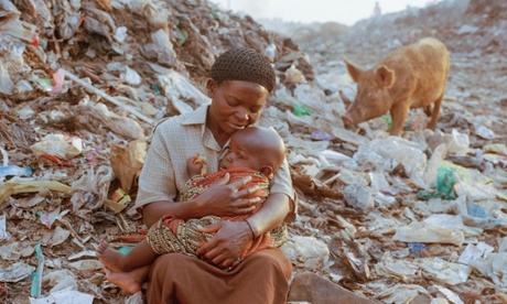 Mothers of the Dump, Eldoret, Kenya : Sarah Nasimiyu is 45 years old and is pictured with her two-year-old Joshua on Eldoret's dump where she worked, Kenya.