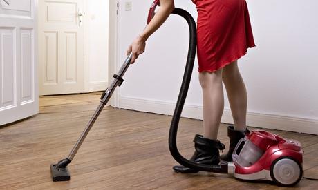 A woman vacuuming