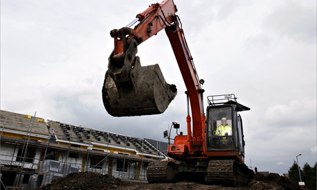An earthmover, digger on the site of a social housing scheme in Stockport