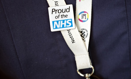 Hospital staff wears a proud of the NHS badge