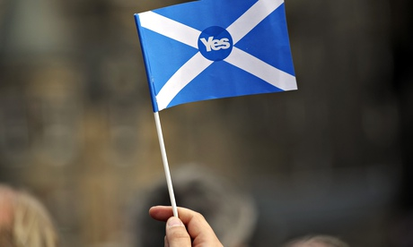 A pro-independence supporter holds a
