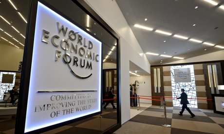 A man enters the Congress Center in Davos