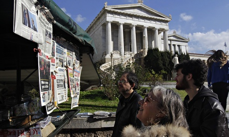 People looking at newspapers in Athens