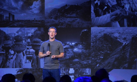 Mark Zuckerberg holds a microphone at a briefing