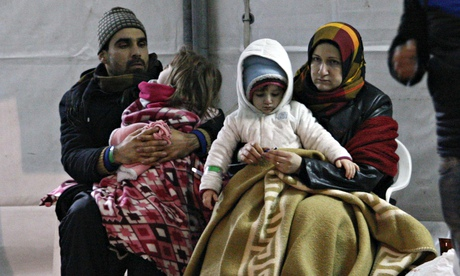 Some of the hundreds of Syrian people rescued by the Italian navy after being abandoned on the Ezade