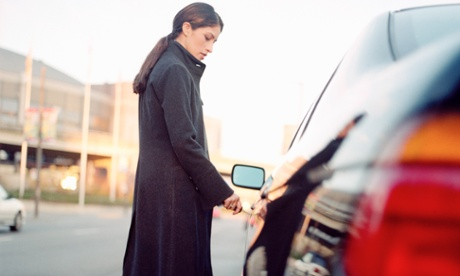 woman locking a car