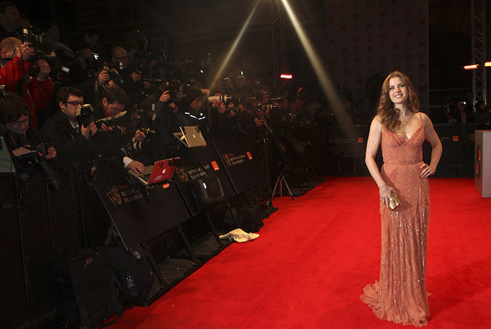 Baftas 2011: fashion: Amy Adams arrives for the Baftas