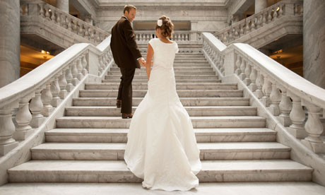 Bride and groom holding hands on steps