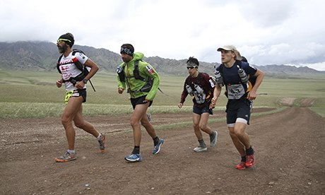 Gobi March 2013 winner Stefano Gregoretti (left) nears the finish line