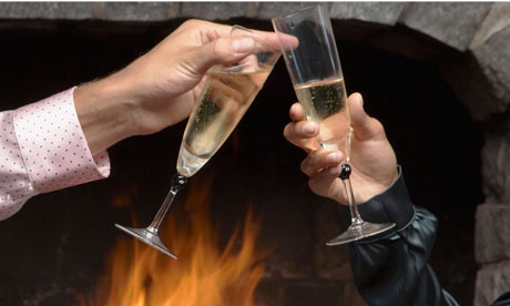 Couple Clinking Glasses by Fireplace