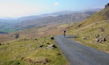 Cyclist climbing Hardknott Pass, The Lake District