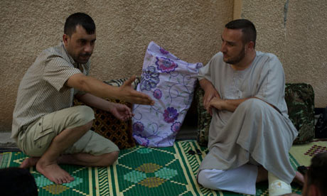 Prisoner Barakat, left, and Sheikh Omar, right, in al-Bab. Photograph by Zac Baillie