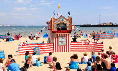 Punch and Judy on the beach at Weymouth, Dorset