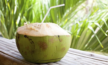 Fresh coconut with straw.