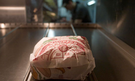A whopper burger sits in the kitchen of a Burger King restaurant in Basildon
