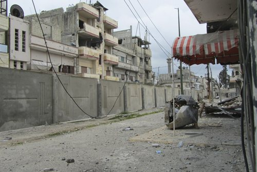 A wall built by the government to separate the al-Insha'at quarter from the Bab Amr district in Homs