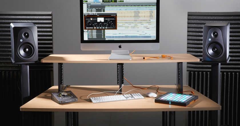 A Home Studio With Sterling MX5 Studio Monitors on Stands Beside a Desk Used for Recording and Mixing Music Music