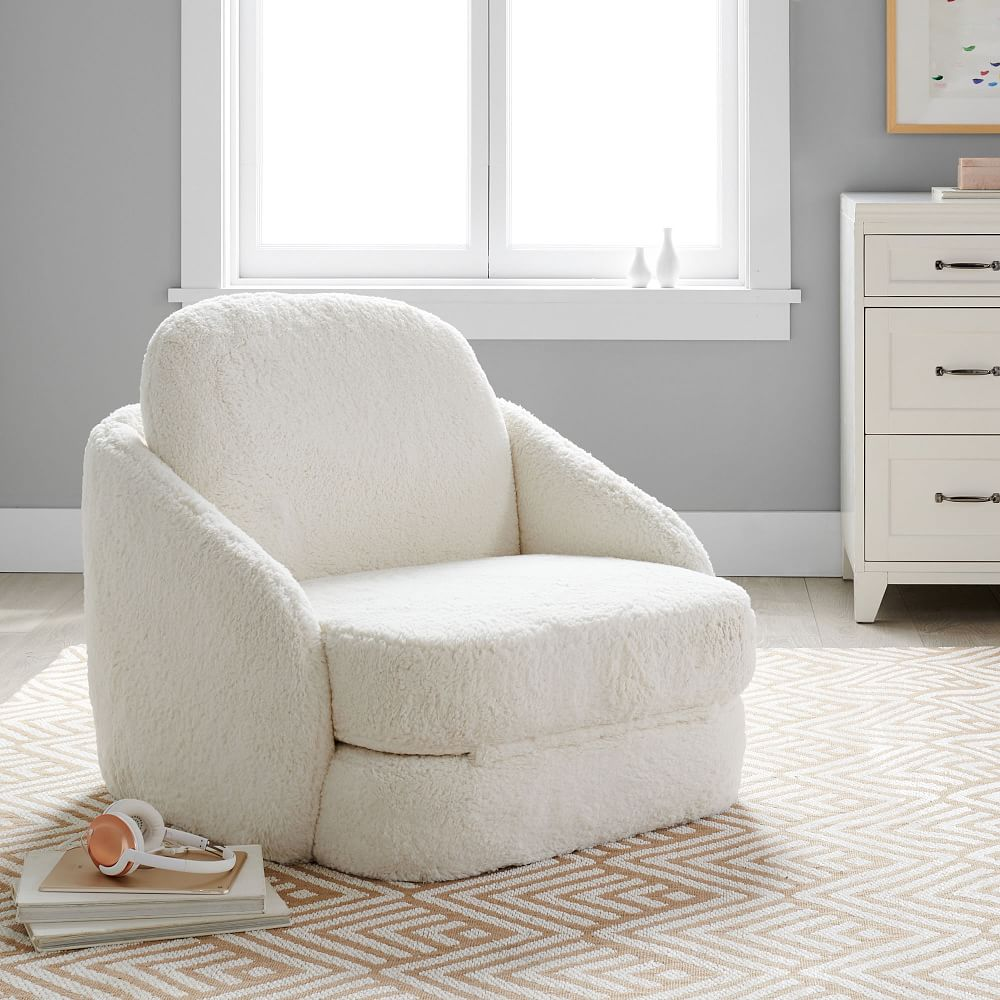 Add a throw, some pillows and perhaps even a snack or two, and you are set for some quality alone time, or even some time with your nearest and dearest. recycled sherpa nico convertible lounge chair ivory white pottery barn teen