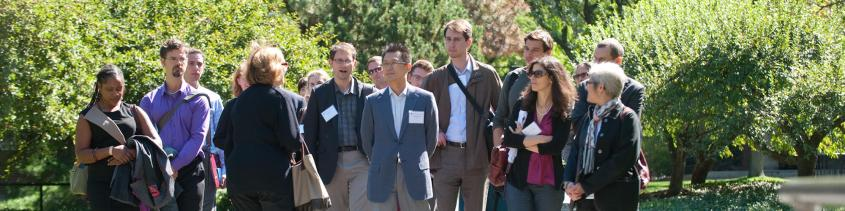 Photo of Harvard Faculty touring Harvard Yard.