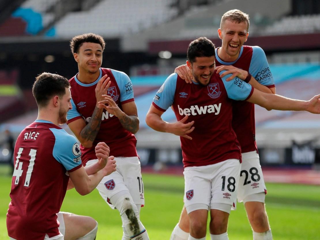 West Ham players celebrate Jesse Lingard's (second left) goal