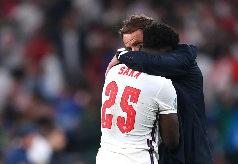 England's Bukayo Saka with manager Gareth Southgate after the match